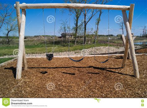 natural swing natural playground swing set wood structure stock photo
