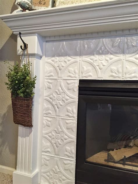 tile fireplace makeover naughton your fireplace makeover with tin tile
