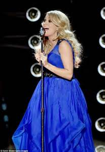 Carrie Underwood Isnt Into Cowboys by Carrie Underwood Wears Asymmetrical White Gown At American