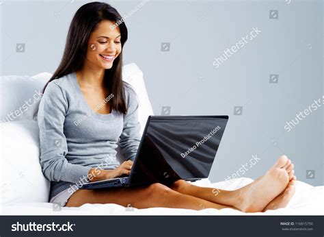 laptop in bed woman using laptop bed home leisure stock photo 116815750 shutterstock
