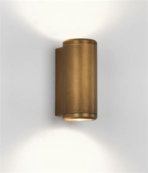 up coastal wall light in antique brass finish