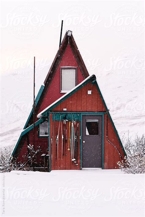 a frame cottage a frame cabin in alaska in the snow by tara romasanta