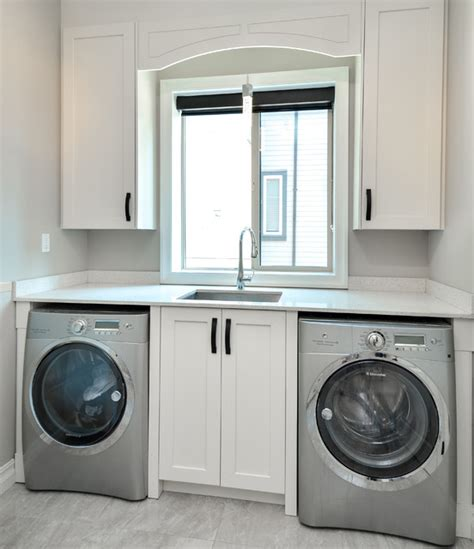 cabinets for the laundry room modern laundry room with shaker style cabinets vancouver