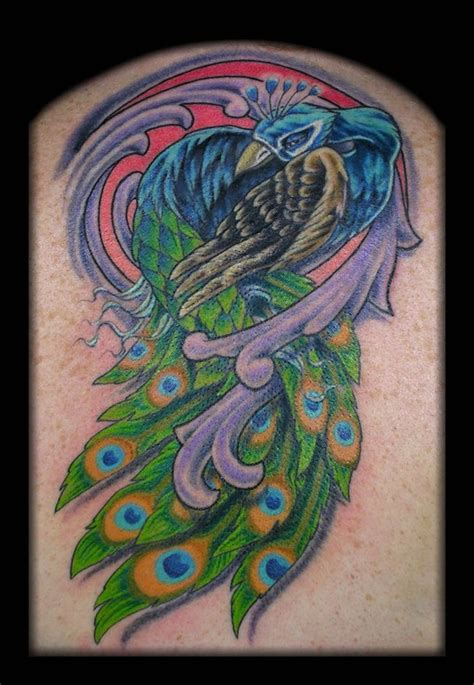 new school peacock tattoo peacock coverup by aaron goolsby tattoonow