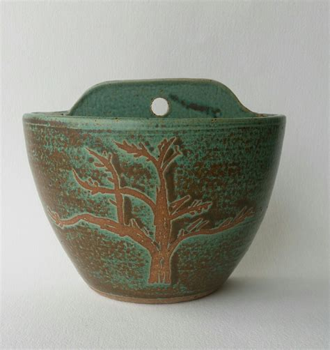 hanging stoneware pottery wall planter with tree by