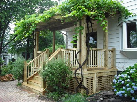 wood porch with vine covered pergola