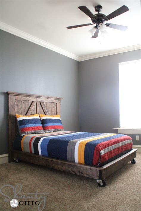 bed on platform diy barn door headboard shanty 2 chic