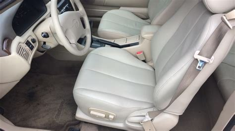 auto upholstery prices choosing vinyl or leather seats as car upholstery options