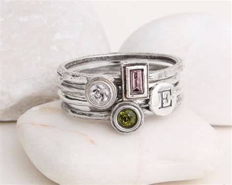s stackable birthstone initial ring stack in