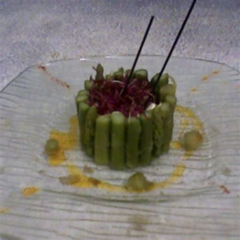 green asparagus goat cheese and flowers with an orange cooking with asparagus