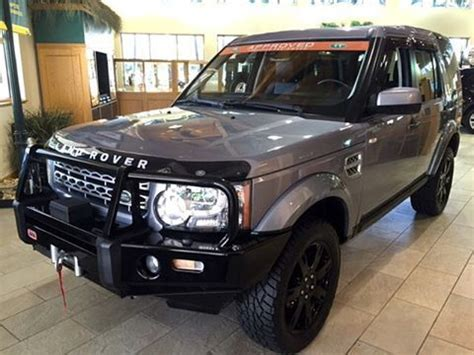 land rover lr4 blacked out black wheels and offroad on
