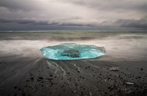 black sand game black sand beach in iceland is dotted with turquoise icebergs