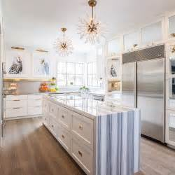 narrow center island fitted with stacked drawers adorned brass kitchen houzz