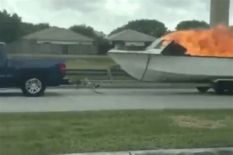 tow boat gif here s video of someone towing a flaming boat down a miami
