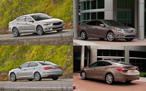 Hyundai Vs Kia Which Is Better Styling Size Up 2014 Kia Cadenza Vs 2013 Hyundai Azera