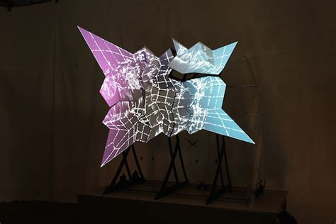 Origami Screen - a light show folds in on an origami projection screen