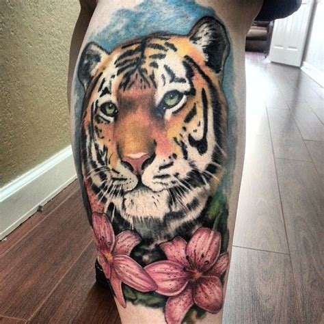 calf muscle tattoo coloured of tiger on the calf tattoos