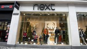 next defies tough times with sales jump in christmas run