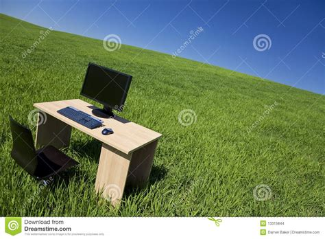 Desk In The Field by Desk And Computer In Green Field With Blue Sky Stock
