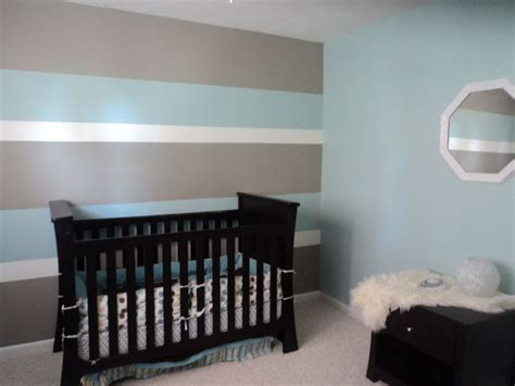 my s nursery hubby and i painted 3 toned horizontal lines for a accent wall now we