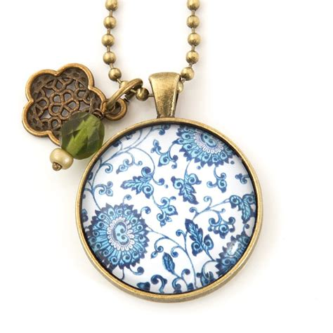 Popits Charm Flower Child flower child pendant with olive glass bead and deco charm nest of pambula
