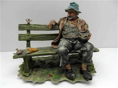 capodimonte man on bench large very rare capodimonte figurine tr on a bench with