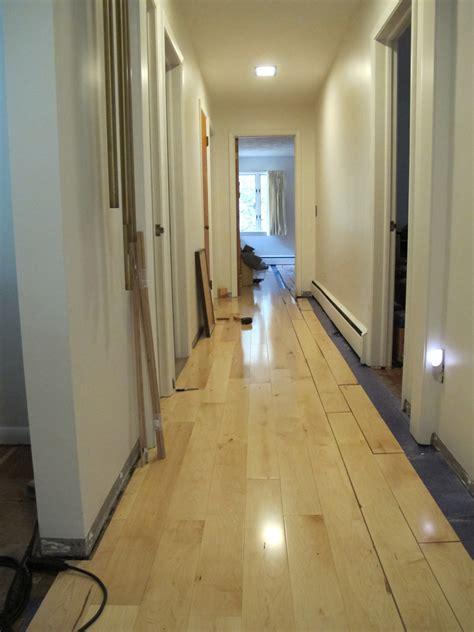 Installing Hardwood Floors In Hallways by A Living Room A Hallway And A New Nursery