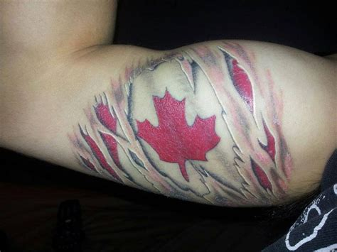 american flag ripping through skin tattoo canadian flag ripping through skin tattoos tattoos