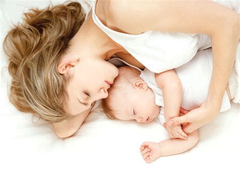 sleeping with baby in bed national expert details benefits of co sleeping little
