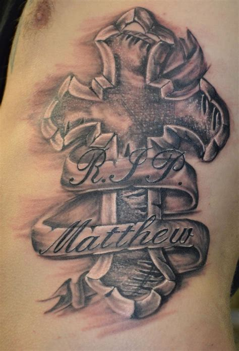 cross on rib cage tattoos by me noah ryan pinterest
