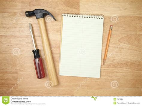 armed with a pad of paper and pencil she began to survey her neighbors pad of paper pencil hammer and screwdriver stock images