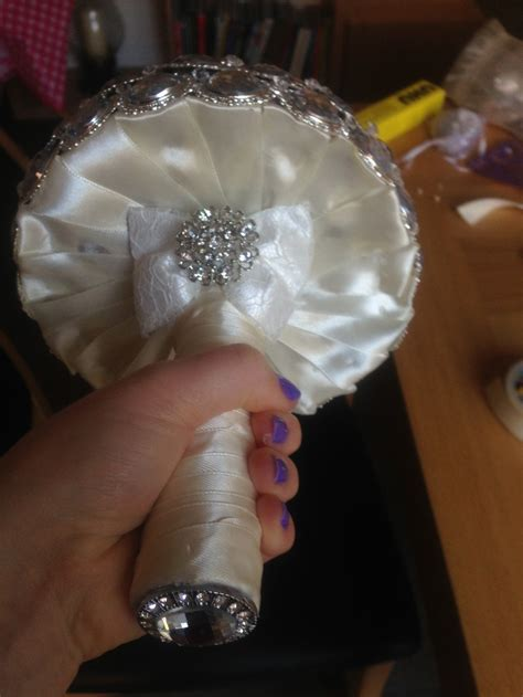 Handle Handbouqet my bridesmaid brooch bouquet the lace bow and at the bottom of the handle dun dun