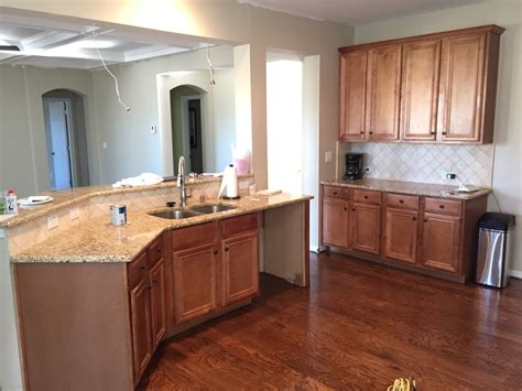 painted wood kitchen cabinets painting kitchen cabinets before after mr painter paints kitchen cabinets