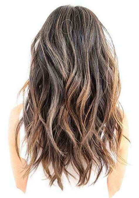 Layers With Soft Waves Hairstyles by Wavy Medium Ash Brown Hair With A Soft Undercut And