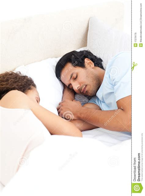 cute couples in bed cute couple sleeping together in their bed stock image