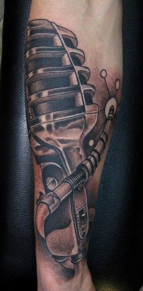 music themed tattoos black and grey vintage microphone arm start to a