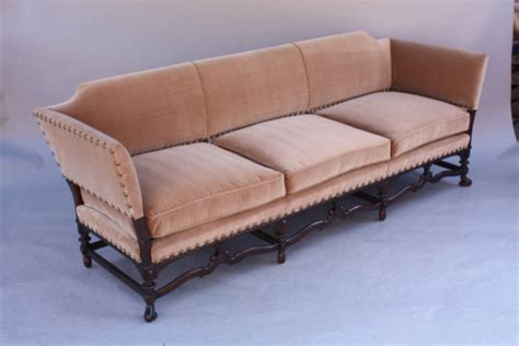 sofa spanish one of two custom walnut spanish revival sofas at 1stdibs