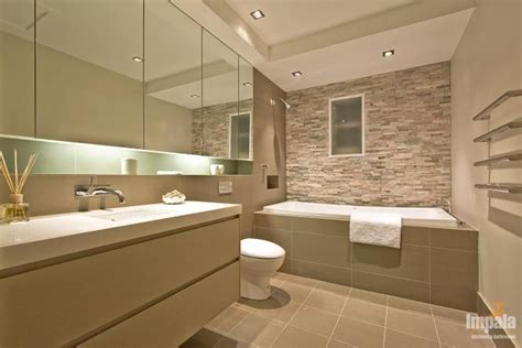 stone coloured bathroom tiles nice colours and overhanging mirror box with lighting