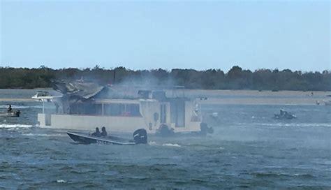 houseboat on fire gold coast good samaritans use jet skis to extinguish boat fire