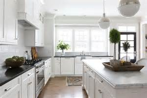 Classic White Kitchen Cabinets by Honed Carrera Marble Countertops Transitional Kitchen