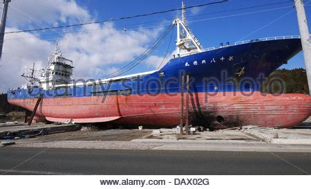 fishing boat washed ashore fishing boat washed ashore by tsunami miyagi japan stock