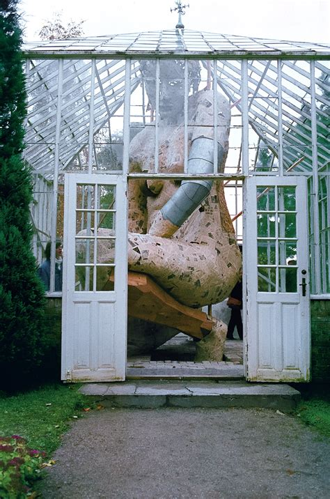 the green house in the greenhouse a towering figure enclosed within a glass greenhouse by susanne