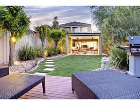 make your backyard design looks greener front yard
