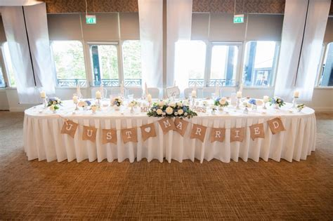 top table arrangements and pillar candles image by zen photographic wedding ideas wedding