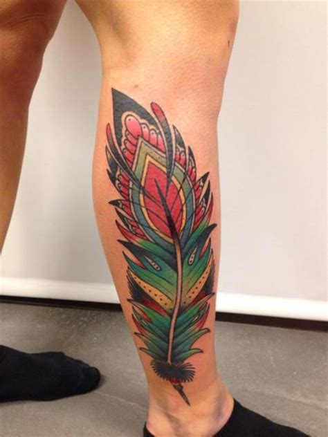 tattoo feather old school tatuaje new school ternero pluma por filip henningsson
