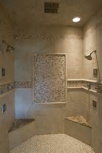 walk in tile shower with tile accents a pebble floor two