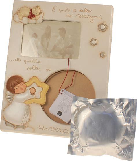 cornice thun prezzi portafoto angelo con calco manina