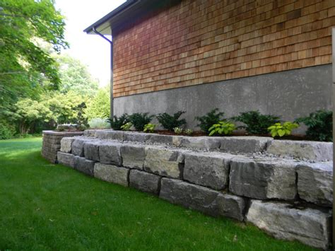 retaining wall side of house cavan hills landscaping retaining walls