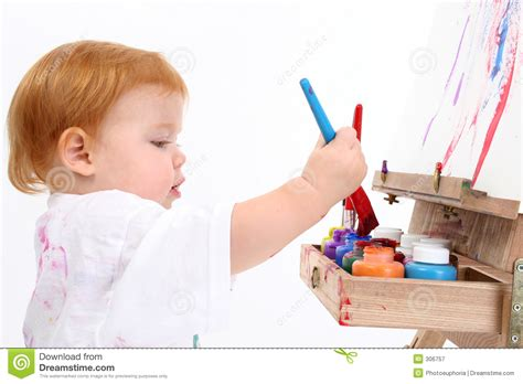 painting baby adorable baby painting at easel stock image image