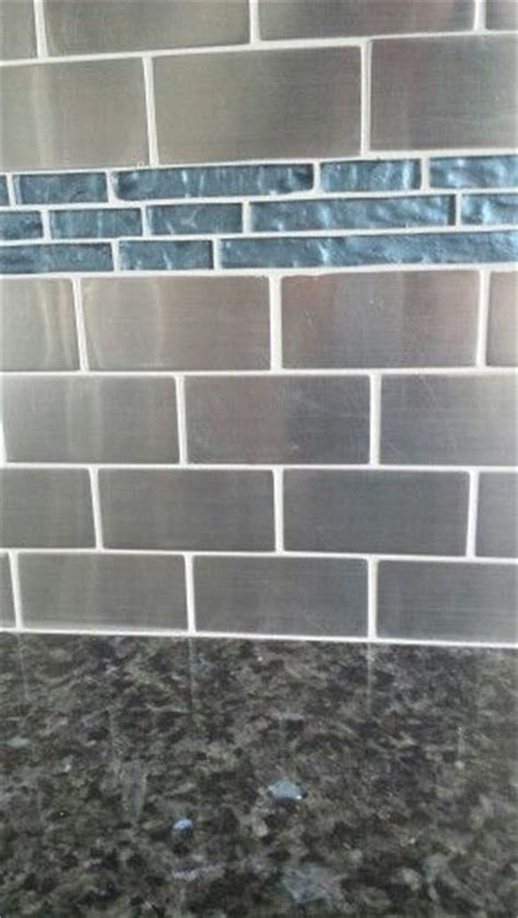 stainless tile kitchen backsplash with blue glass tile matched with blue pearl granite